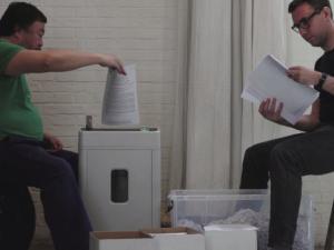Artist Ai Weiwei and activist Jacob Applebaum shreadding NSA documents. (Image: Film still courtesy Praxis Films)