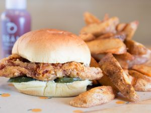 David Chang's spicy fried chicken sandwich at Fuku, in the East Village. (Photo: Gabriele Stabile)
