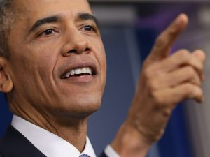 WASHINGTON, DC - DECEMBER 19: U.S. President Barack Obama speaks to members of the media during his last news conference of the year in the Brady Press Briefing Room at the White House December 19, 2014 in Washington, DC. President Obama faced questions on various topics including the changing of Cuba policy, the computer hack of Sony by North Korea, his executive action on immigration and his plan on working with a Republican majority Congress. (Photo by Chip Somodevilla/Getty Images)