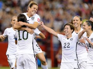 The women's soccer team celebrates after an earlier victory in June (Photo: Minas Panagiotakis/Getty Images).