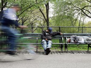 NEW YORK - MAY 02: Men sleep on park benches May 2, 2007 in New York City. New York City released its Homeless Outreach Population Estimate (HOPE) today which concluded that unsheltered homelessness is down 15 percent from 2005. The report also showed that among the homeless, 19 percent fewer individuals are living on city streets or in parks since January 2006. (Photo by Mario Tama/Getty Images)