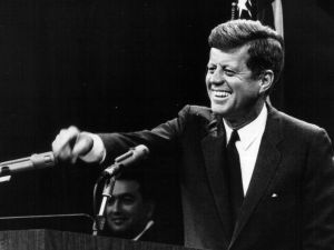 381091 23: President John F. Kennedy laughs during a press conference August 9, 1963. (Photo by National Archive/Newsmakers)