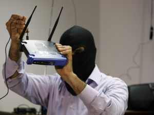 A masked Lebanese secret service officer shows to the media at the Lebanese security services headquarters in Beirut on May 11, 2009 a wireless internet router found with arrested Lebanese nationals accused of spying for Israel. Lebanese authorities have arrested at least 17 suspected spies working for Israel since January. Lebanon and Israel are technically at war and if found guilty the suspected spies could be sentenced to death on charges of high treason. AFP PHOTO/JOSEPH BARRAK