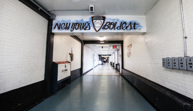 """Correction officers call themselves """"New York's Boldest,"""" seen here painted on halls of the George Motchan Detention Center on Rikers Island."""