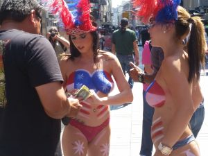 Topless performers in Times Square. (Photo: Ross Barkan for Observer)