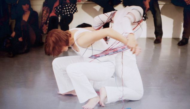Mary Valverde, Allegiance Dance (Video Still No.3), (2011). Performance with Chloe Reison. (Photo: Artist's Website)