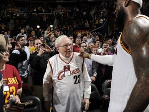 CLEVELAND, OH - DECEMBER 15: Warren Buffett and LeBron James #23 of the Cleveland Cavaliers talk after the game against the Charlotte Hornets on December 15, 2014 at Quicken Loans Arena in Cleveland, Ohio. NOTE TO USER: User expressly acknowledges and agrees that, by downloading and/or using this Photograph, user is consenting to the terms and conditions of the Getty Images License Agreement. Mandatory Copyright Notice: Copyright 2014 NBAE (Photo by David Liam Kyle/NBAE via Getty Images)