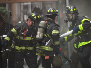 Firefighters put out a fire in Manhattan. (Photo: Spencer Platt/Getty Images)