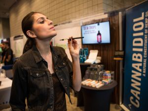 NEW YORK, NY - JUNE 19: A woman poses while smoking a vape stick at the Cannabis World Congress Expo on June 19, 2015 in New York City. Marijuana consumption is growing into a multimillion dollar industry as marijuana use - both recreational and medicinal- becomes legal in more U.S. states and more socially accepted. (Photo by Andrew Burton/Getty Images)