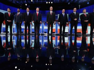 Chris Christie (l) and John Kasich (r) are far apart on stage but close as friends and in style. That's why the Kasich surge in New Hampshire might prove problematic for Christie. (Chip Somodevilla/Getty Images)