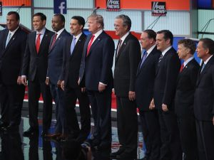 CLEVELAND, OH - AUGUST 06: Republican presidential candidates (L-R) New Jersey Gov. Chris Christie, Sen. Marco Rubio (R-FL), Ben Carson, Wisconsin Gov. Scott Walker, Donald Trump, Jeb Bush, Mike Huckabee, Sen. Ted Cruz (R-TX), Sen. Rand Paul (R-KY) and John Kasich take the stage for the first prime-time presidential debate hosted by FOX News and Facebook at the Quicken Loans Arena August 6, 2015 in Cleveland, Ohio. The top-ten GOP candidates were selected to participate in the debate based on their rank in an average of the five most recent national political polls. (Photo by Scott Olson/Getty Images)