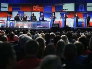 Guests watch Republican presidential candidates speak during the first Republican presidential debate hosted by Fox News and Facebook at the Quicken Loans Arena on August 6, 2015 in Cleveland, Ohio. (Photo by Scott Olson/Getty Images)
