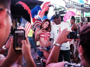 A body painted woman poses with a tourist in Times Square.