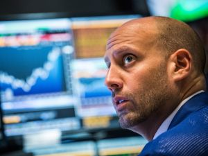 A trader works on the floor of the New York Stock Exchange during Wednesday's 620 point rally (Photo: Andrew Burton for Getty Images)