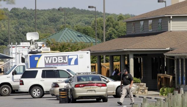 MONETA, VA - AUGUST 26: The TV truck that journalists Alison Parker and Adam Ward drove before they were killed this morning during a live broadcast sits in a parking lot near the scene on August 26, 2015 in Moneta, Virginia. Two employees of WDBJ TV were killed this morning during a live broadcast at Bridgewater Plaza on Smith Mountain Lake. The victims have been identified as reporter Alison Parker and cameraman Adam Ward. Parker, 24 and Ward, 27, worked for WDBJ in Roanoke, Virginia. The suspect, Vester Lee Flanigan, also known as Bryce Williams, died of a self-inflicted gunshot wound. (Photo by Jay Paul/Getty Images)