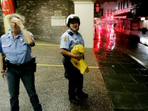 NEW ORLEANS - AUGUST 28: New Orleans Policers look out into an ally in The French Quarter where debris is starting to fly caused by Hurricane Katrina August 29, 2005 iin, New Orleans Louisiana, Katrina has been down graded to a category 4 storm as it approached New Orleans. (Photo by Mark Wilson/Getty Images)