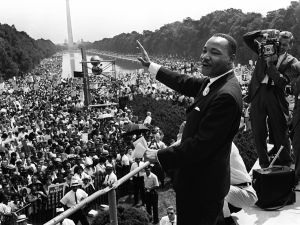 """The civil rights leader Martin Luther KIng (C) waves to supporters 28 August 1963 on the Mall in Washington DC (Washington Monument in background) during the """"March on Washington"""". King said the march was """"the greatest demonstration of freedom in the history of the United States."""" Martin Luther King was assassinated on 04 April 1968 in Memphis, Tennessee. James Earl Ray confessed to shooting King and was sentenced to 99 years in prison. King's killing sent shock waves through American society at the time, and is still regarded as a landmark event in recent US history. AFP PHOTO (Photo credit should read -/AFP/Getty Images)"""