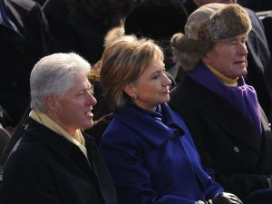 Former US president Bill Clinton (L), his wife Hillary Rodham Clinton (C), and former US president George H.W. Bush (R) attend inaugural ceremonies for Barack Obama (ROBYN BECK/AFP/Getty Images)