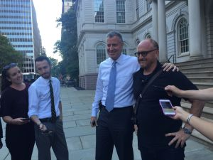 Bill de Blasio and Louis CK stop for a picture outside City Hall. (Photo: Jillian Jorgensen for Observer)