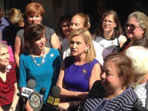 Congresswoman Carolyn Maloney, center, called for gender equity in Times Square (Photo: Will Bredderman for Observer).