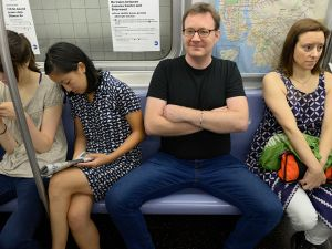 Manspreading on a subway car. (Photo: Richard Yeh / WNYC)