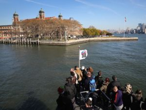 A boat carrying tourists arrives at Ellis Island after it was re-opened to the public on October 28, 2013 in New York City. (Photo: John Moore/Getty Images)