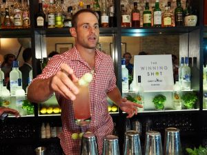 "Andy Roddick mixing a Grey Goose ""Honey Deuce"" at MACE Bar (Photo: Grey Goose)."