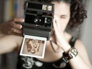 Girl taking an instant photo