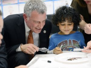 Mayor Bill de Blasio works with a student on a science project during a visit to a pre-K classroom in Manhattan.