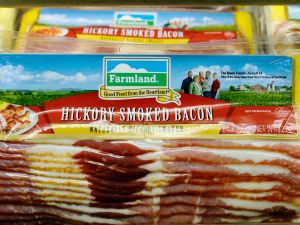LOS ANGELES, CA - MAY 29: Farmland's hickory smoked bacon is on sale at a supermarket on May 29, 2013 in Los Angeles, California. Farmland is a brand owned by Smithfield Foods Inc, which is the biggest pork producer in the world. A Chinese company based in Hong Kong, Shuanghui International Holdings Ltd. has agreed to buy Smithfield Foods Inc. for approximately $4.72 billion (Photo by Kevork Djansezian/Getty Images)