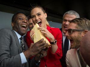 Brand ambassadors bite into swiss cheese. (Photo: Hublot)