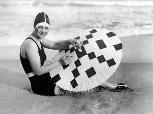 A model, circa 1925, creates a crossword design on her parasol in Palm Beach, Florida. (Photo: Getty Images)