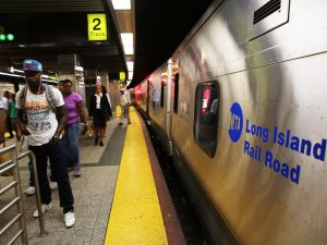 A Long Island Rail Road (LIRR) train sits at the platform. (Photo by Spencer Platt/Getty Images)