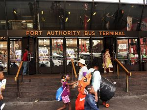 NEW YORK, NY - AUGUST 21: An entrance to the Port Authority Bus Terminal is viewed on August 21, 2014 in New York City. The Port Authority Bus Terminal, which opened in 1950, is New York City's largest bus depot and has long been derided as dirty and inefficient. Leaking ceilings, unsanitary bathrooms, late buses and a long standing problem with the homeless have added to the terminals reputation. While many commuters and transportation advocates are rallying for a new terminal, the Port Authority of New York and New Jersey has announced that they agency plan to spend up to $260 million on maintenance in the coming years. (Photo by Spencer Platt/Getty Images)