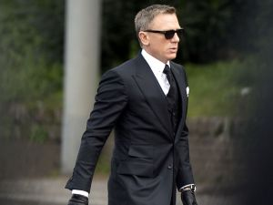 English actor Daniel Craig walks during the shooting of scenes for the 24th James Bond movie 'Spectre' in Rome on February 21, 2015. The 24th film in the Bond film series, 'Spectre' is slated for release later this year. AFP PHOTO / TIZIANA FABI (Photo credit should read TIZIANA FABI/AFP/Getty Images)