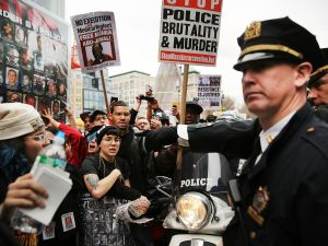 Protesters scuffle with police during a march against police violence in Manhattan on April 14, 2015