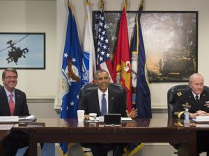 US President Barack Obama holds a meeting with Secretary of Defense Ashton Carter (L), Chairman of the Joint Chiefs of Staff Martin Dempsey (R) and top military officials at the Pentagon in Washington, DC, July 6, 2015. Obama is at the Pentagon on Monday for an update on the campaign against the Islamic State group in Iraq and Syria. The briefing on US-led efforts to dismantle the jihadist group follows coalition air strikes that hit its de facto capital Raqa in Syria over the weekend. AFP PHOTO / SAUL LOEB (Photo credit should read SAUL LOEB/AFP/Getty Images)