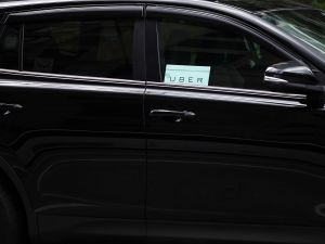 State and federal regulation of driverless cars could be beneficial to the transportation industry―even Uber drivers are facing pay cuts. (Photo: Spencer Platt/Getty Images)