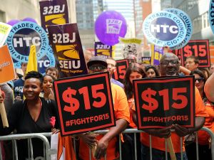 Labor leaders, workers and activists attend a rally for a $15 minimum hourly wage on July 22, 2015 in New York City.