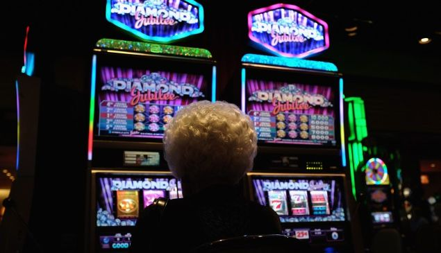 ATLANTIC CITY, NJ - AUGUST 29: An elderly woman plays slot machines in a casino on the Atlantic City Boardwalk on August 29 in Atlantic City, New Jersey. After new casinos opened in neighboring states, four of the city's top casinos closed in 2014, laying-off some 8,000 workers. The closures brought Atlantic City's unemployment rate to more than 11 percent, double the national average. The mass unemployment has produced the highest foreclosure rate of any metropolitan U.S. area, with 1 out of 113 homes now in foreclosure in Atlantic County. (Photo by John Moore/Getty Images)