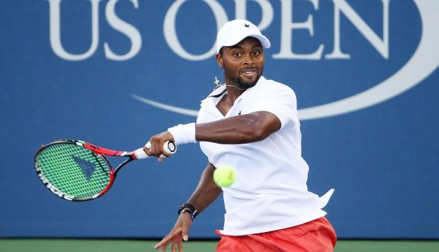 NEW YORK, NY - SEPTEMBER 05: Donald Young of the United States returns a shot to Viktor Troicki of Serbia during their Men's Singles Third Round match on Day Six of the 2015 US Open at the USTA Billie Jean King National Tennis Center on September 5, 2015 in the Flushing neighborhood of the Queens borough of New York City. (Photo by Streeter Lecka/Getty Images)