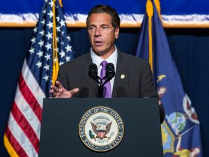 NEW YORK, NY - SEPTEMBER 10: New York Governor Andrew Cuomo announces his support to raise the minimum wage for the state of New York to $15 per hour on September 10, 2015 in New York City. U.S. Vice President Joe Biden, who also attended the announcement, said he would like to see the federal minimum wage risen to $12 per hour. (Photo by Andrew Burton/Getty Images)