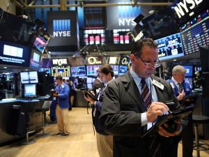 NEW YORK, NY - SEPTEMBER 11: Traders work on the floor of the New York Stock Exchange (NYSE) on September 11, 2015 in New York City. The Dow was down 50 points in morning trading. Throughout the nation people are holding somber gatherings and memorial events to reflect on the 14-year anniversary of the 9/11 attacks that resulted in the loss of nearly 3,000 people. (Photo by Spencer Platt/Getty Images)