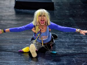 Betsey Johnson does her signature gymnastics routine at the end of her NYFW runway show. (Photo: Getty Images)