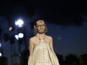 Givenchy's face jewelry (Photo: Joshua Lott/AFP/Getty Images)