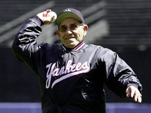 Former New York Yankees catcher Yogi Berra throws out the first pitch to start the home season for the New York Yankees 12 April, 2000 in New York. The Yankees played their opener against the Texas Rangers. (ELECTRONIC IMAGE) AFP PHOTO/Henny Ray ABRAMS (Photo credit should read HENNY RAY ABRAMS/AFP/Getty Images)