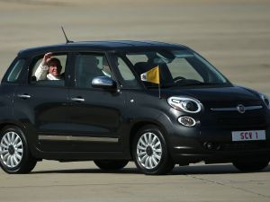 Pope Francis arrives for his departure from Washington, DC en route to New York City in his Fiat. (Photo by Patrick Smith/Getty Images)