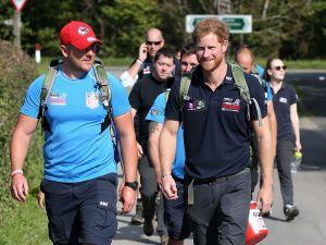 Prince Harry walks alongside a veteran. (Photo: Getty)