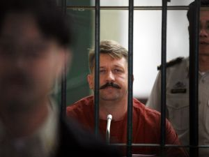 BANGKOK, THAILAND - JULY 28: Viktor Bout sits inside a detention cell at Bangkok Supreme Court on July 28, 2008, in Bangkok, Thailand. A Thai court postponed the extradition hearing, for a second time, of Viktor Bout, after his attorney failed to turn up on Monday for the hearing to extradite Bout to the U.S. to face terrorism charges in connection to alleged arms smuggling. (Photo by Chumsak Kanoknan/ Getty Images)