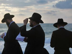TEL AVIV, ISRAEL - SEPTEMBER 20: Ultra-Orthodox Jews perform the Tashlich prayer while facing the Mediterranean Sea at sunset of the second day of Rosh Hashanah, the Jewish new year, on September 20, 2009 in Tel Aviv, Israel. Tashlich, which means 'to cast away', is the practice by which Jews go to a flowing body of water and symbolically 'throw away' their sins during the days of repentance between Rosh Hashanah and the upcoming day of atonement, or Yom Kippur, the holiest day in the Jewish calendar. (Photo by David Silverman/Getty Images)